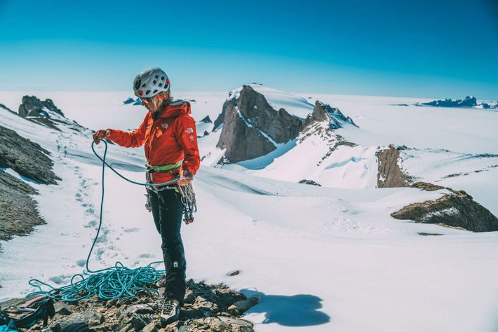 Anna Pfaff gathers her gear in preparation for a freezing Antarctic climb.