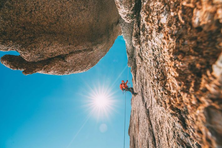 Jimmy Chin moves up a new route on the face of Ulventanna.