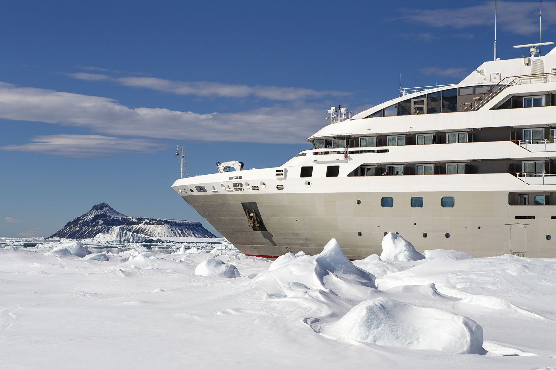 Le Soléal wedged into the ice to allow passengers to disembark.