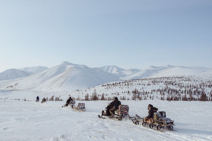 Reindeer herders from Kyusyur, Yakutia, move to another encampment before the annual March vaccination of their ...