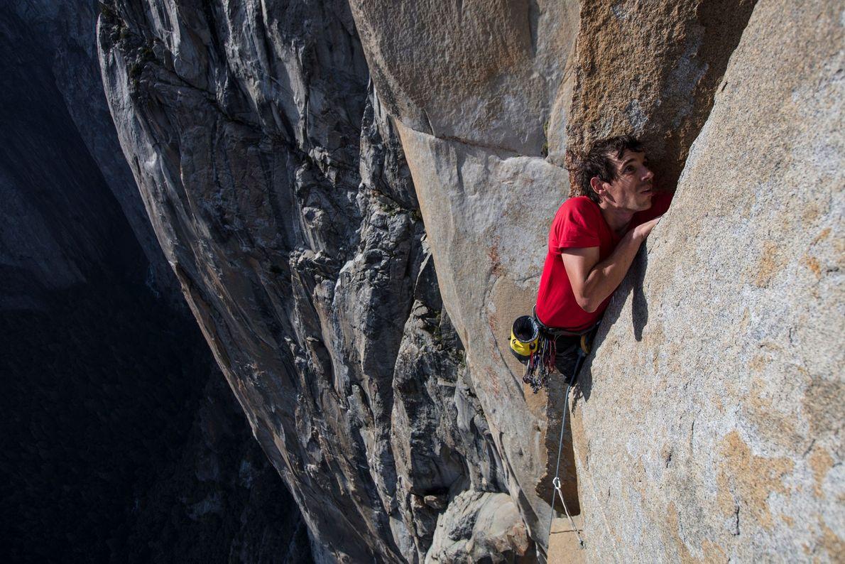 Honnold reaches into a crevice during a free climb of El Capitan.