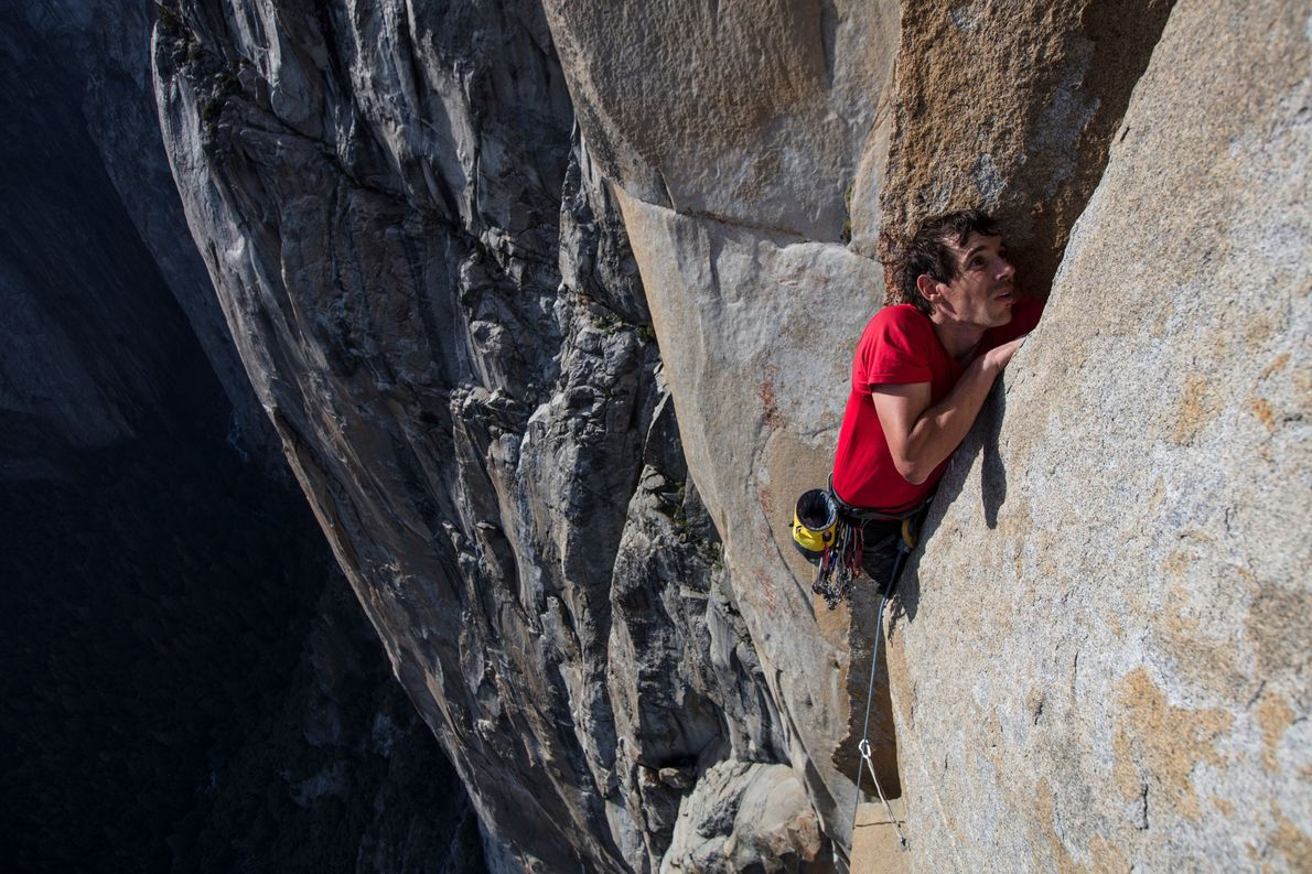 Honnold reaches into a crevice during a free climb of El Capitan.