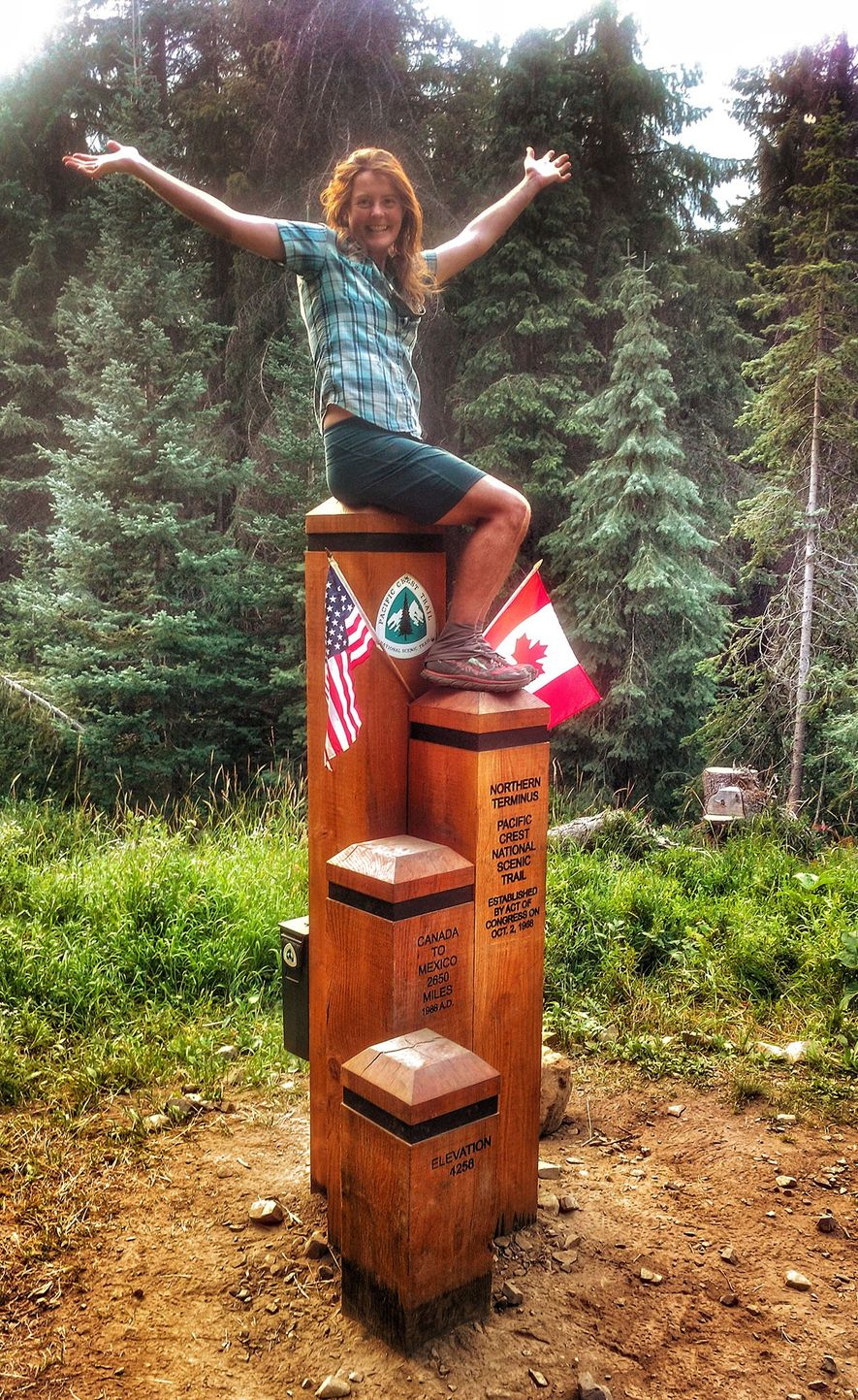 Anderson sits atop Monument 78, which marks the northern end of the Pacific Crest Trail in ...