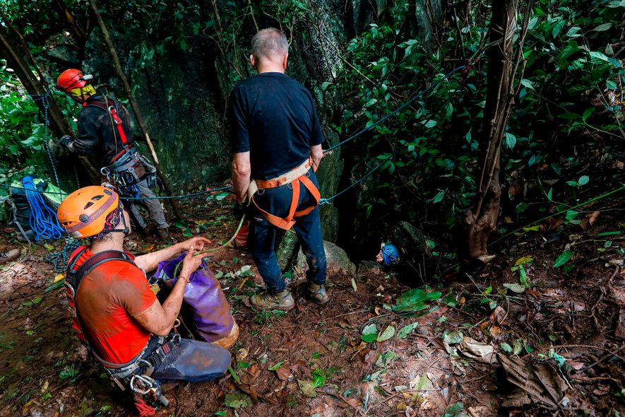 A team of British cave divers explores an opening in a mountain near Chiang Rai, Thailand, ...