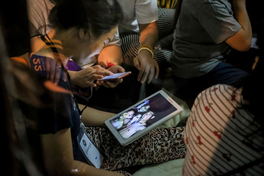 Relieved relatives of the missing share photos after all 12 boys and their coach were found ...