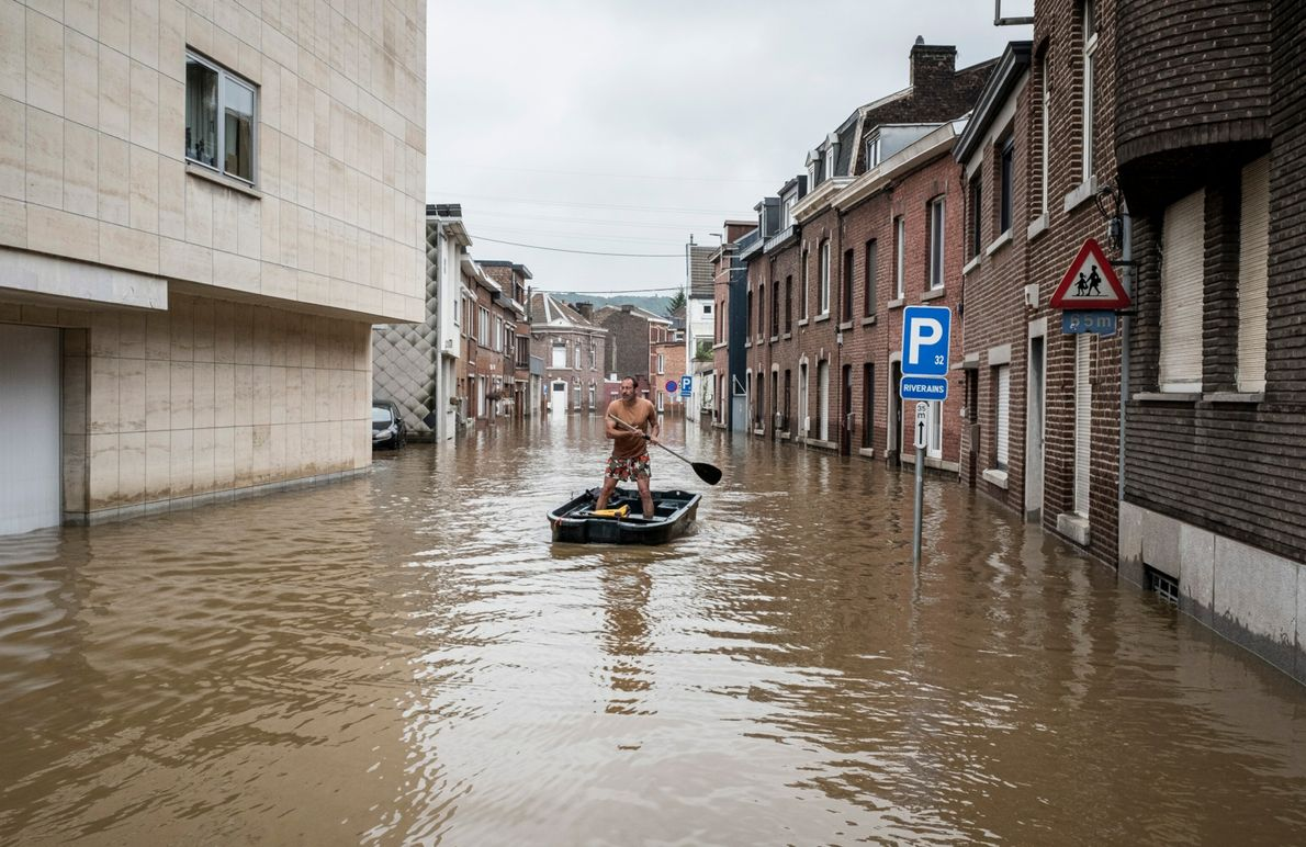 A man rows a boat down a flooded residential street in Belgium on Friday July 16, ...