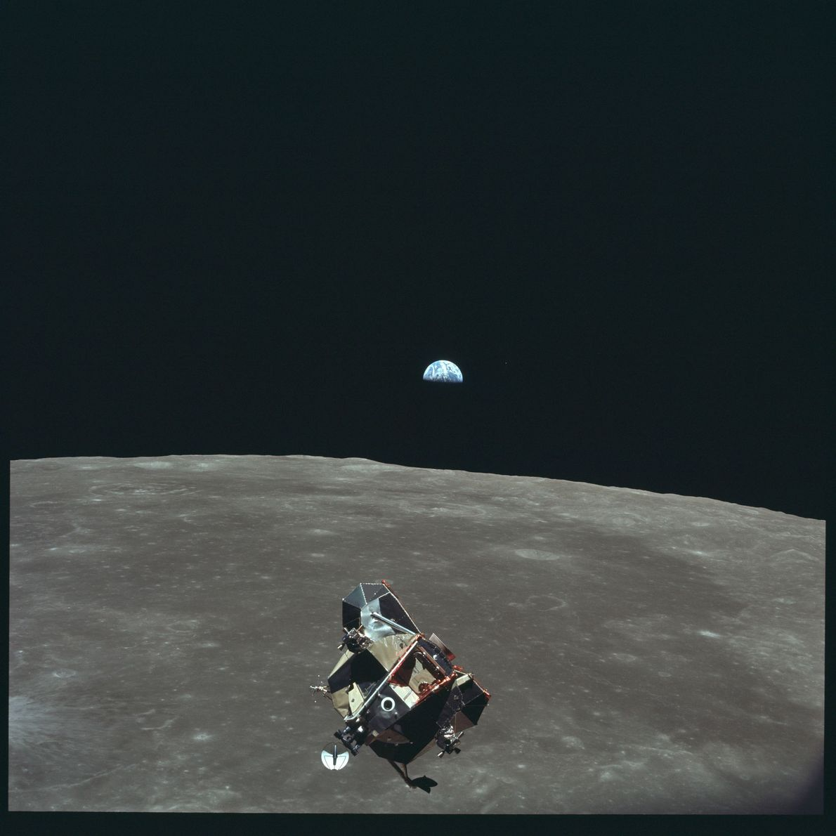 Photographed from the command module while in orbit, the Apollo 11 lunar module floats above the ...