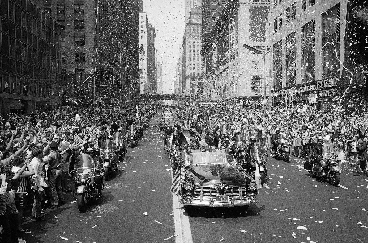 New Yorkers line 42nd Street to cheer the Apollo 11 astronauts on August 13, 1969. Buzz ...