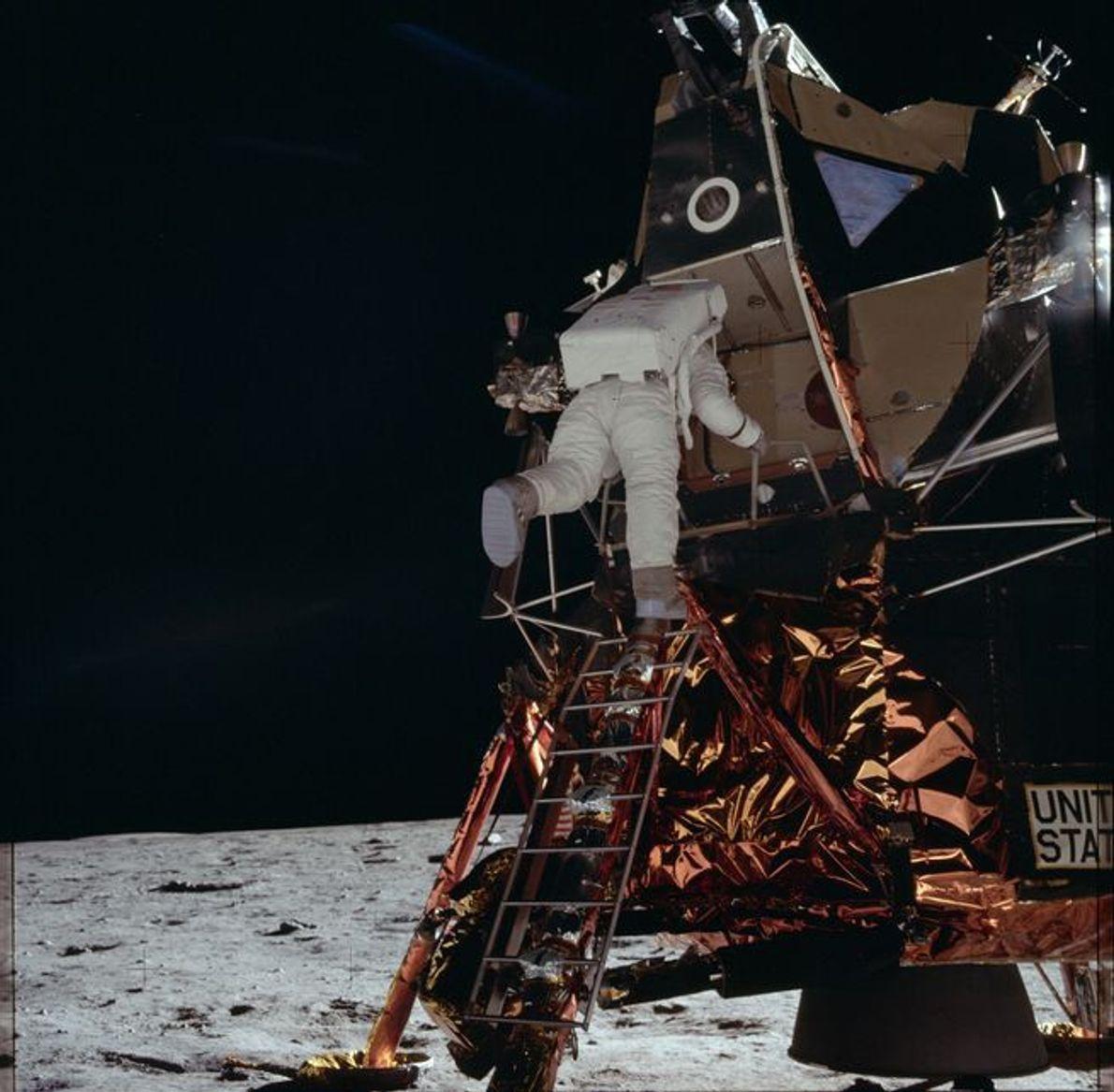 Astronaut Buzz Aldrin exits the Eagle lunar module as he prepares to take his historic walk ...