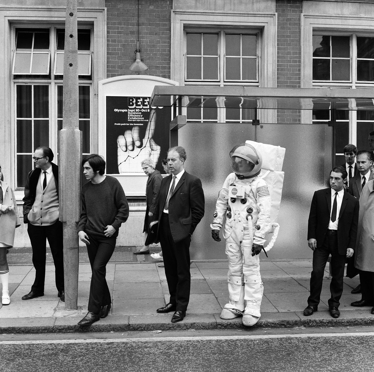 Englishman Jonathan Bosley stands on a London street dressed as an Apollo 11 astronaut in September ...