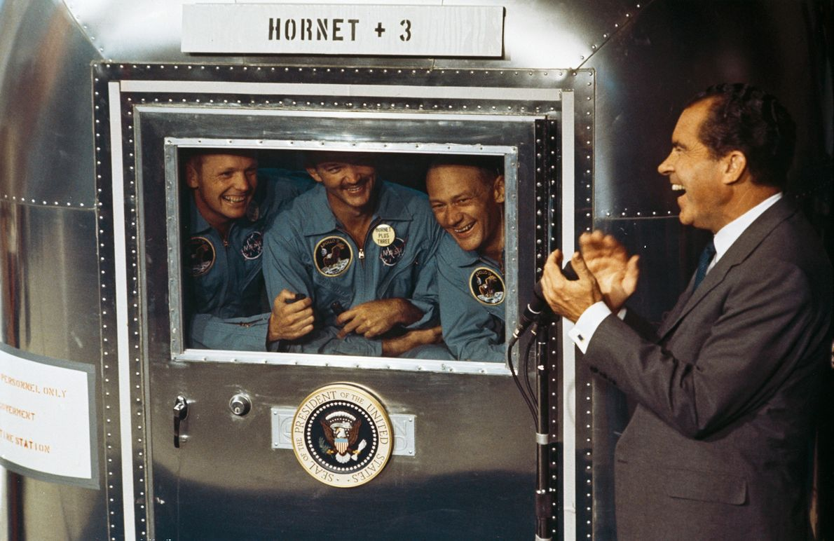 From left to right, Apollo 11 astronauts Neil Armstrong, Michael Collins, and Buzz Aldrin talk to ...