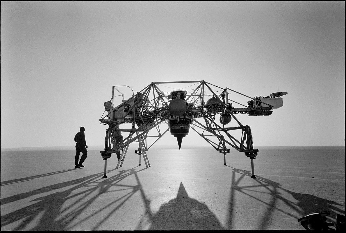 Astronaut Neil Armstrong stands with a moon landing research vehicle at Edwards Air Force Base in ...