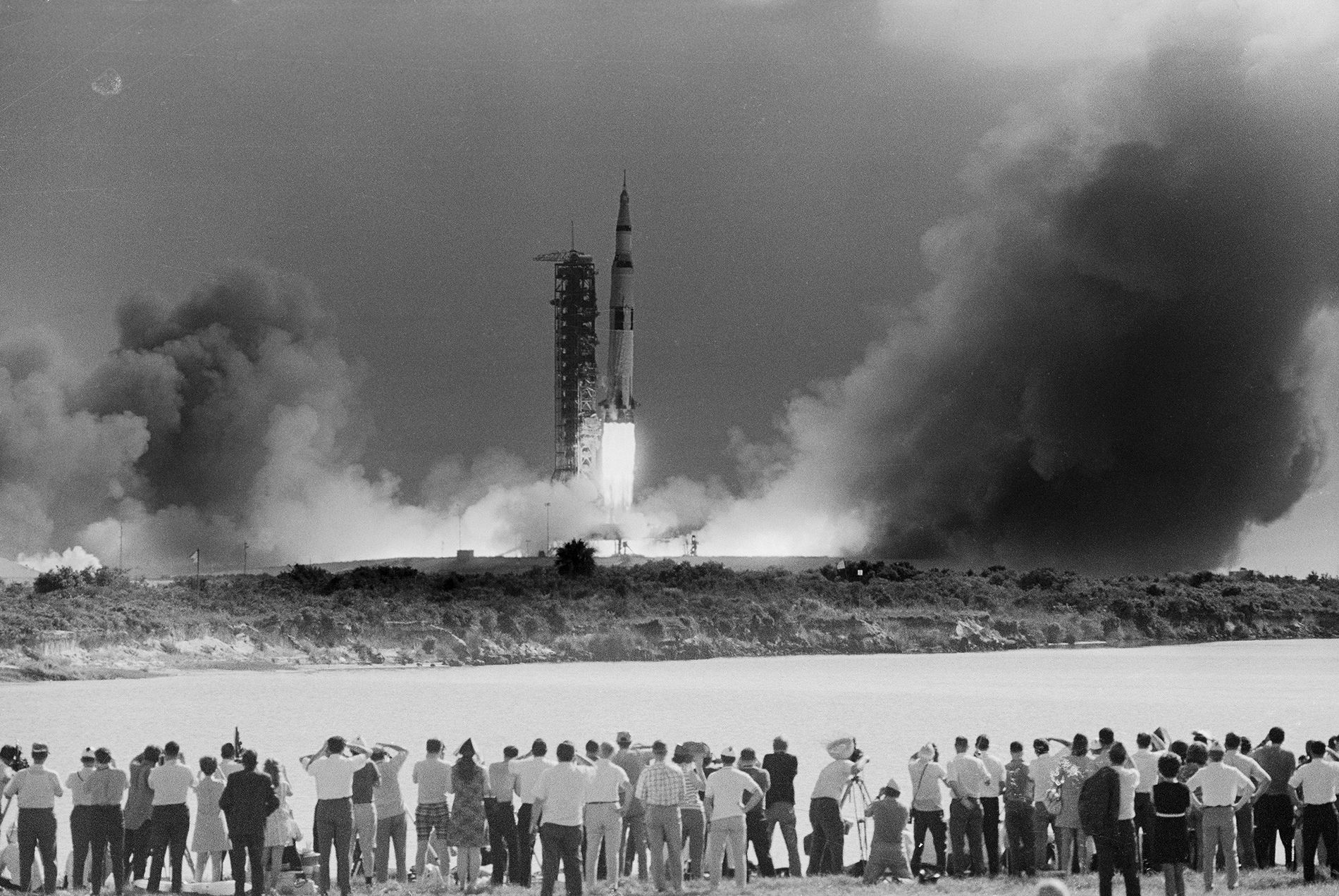 A crowd gathers on Cocoa Beach to watch the Apollo 11 mission blast off from Cape ...