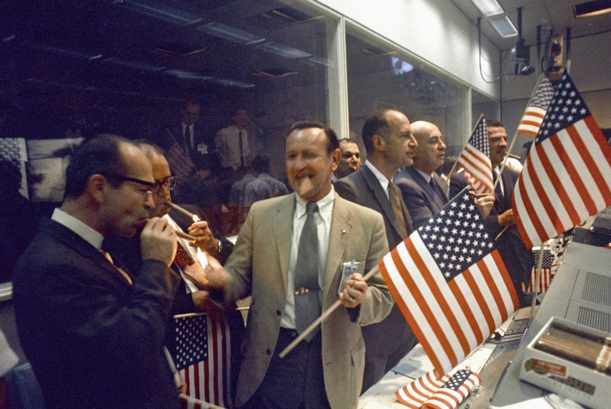 NASA officials join the flight controllers at the Manned Spaceflight Center in Houston, Texas, in celebrating ...