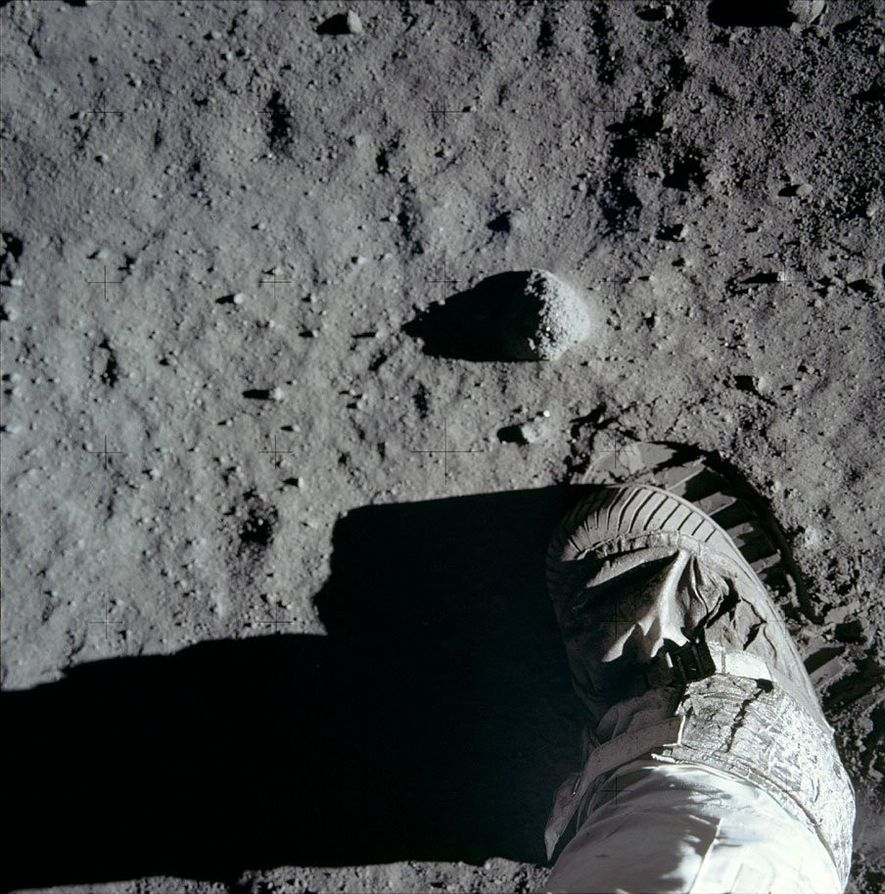A close-up of the lunar surface reveals pebbles, dust, and Buzz Aldrin's boot. Aldrin took this ...