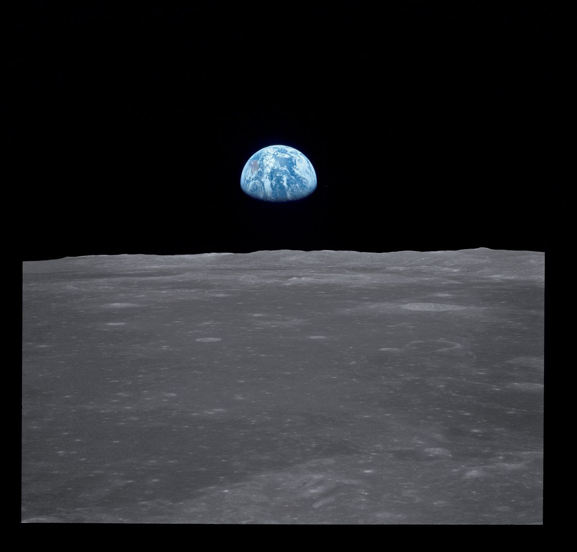 This view of Earth rising over the moon's horizon was taken from the Apollo 11 spacecraft ...