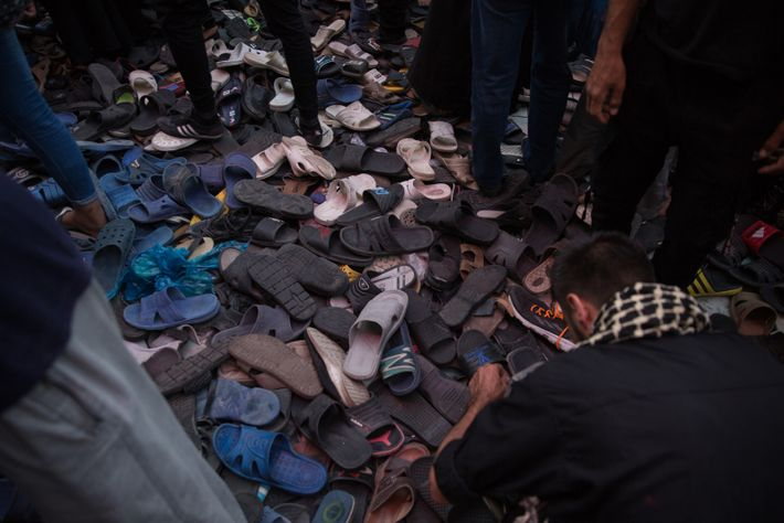 Piles of shoes at the entrance to the shrine.