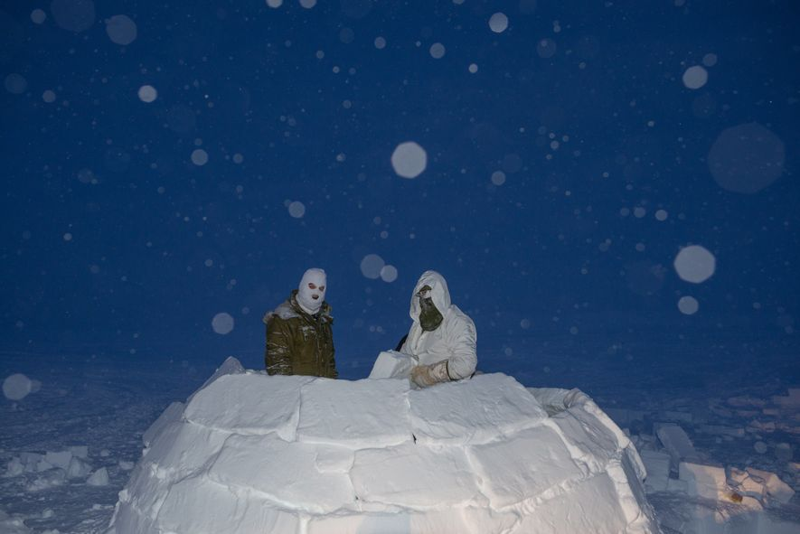 Canadian soldiers build an igloo during the high Arctic phase of their training to become Arctic ...