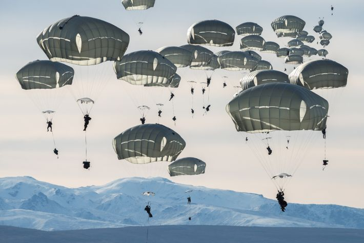 Some 400 U.S. soldiers practice parachute jumps near Alaska's Fort Greely. The multinational exercise, which includes ...