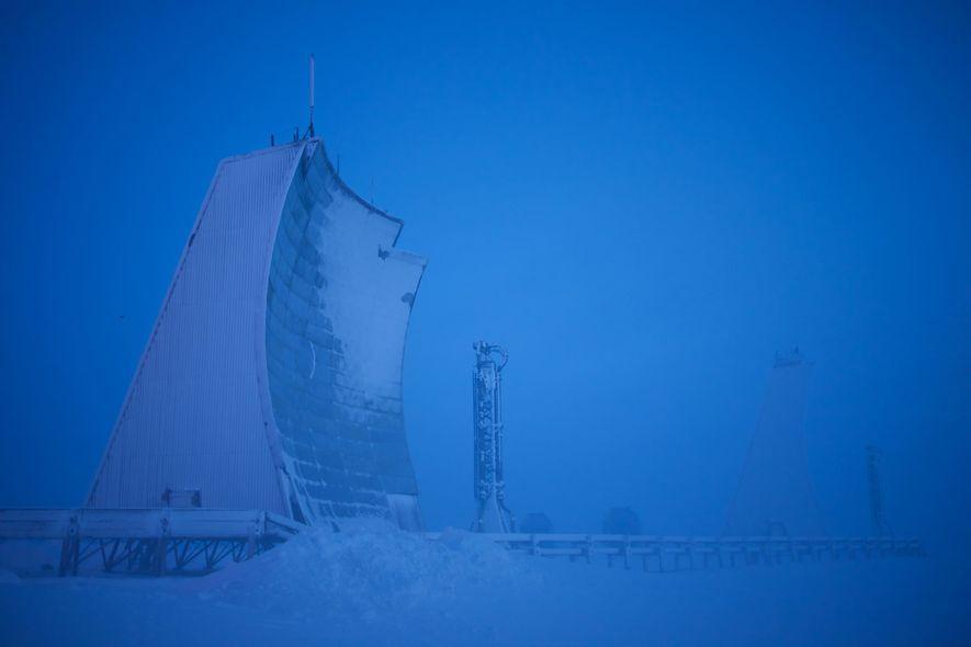 A long-range radar installation rears up from the tundra in Hall Beach, Nunavut, Canada. The radar …