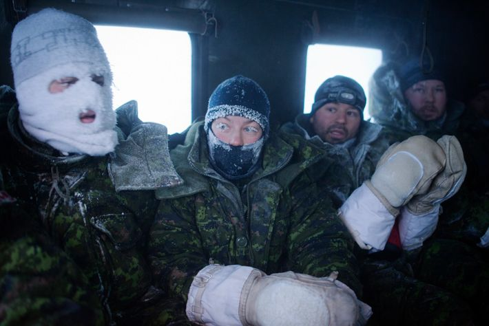 Frost-faced members of a Canadian aircrew head back to hot meals and showers after enduring a ...