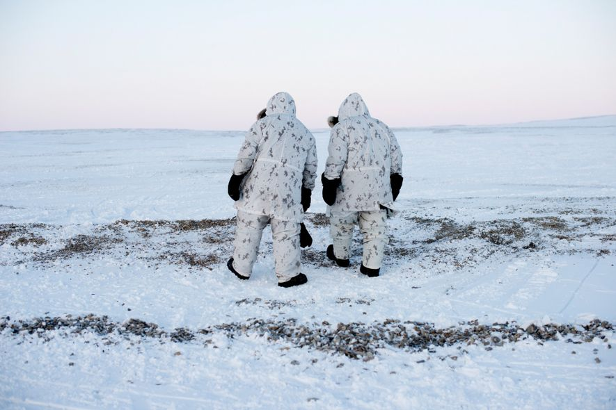 'Keep moving' is a key principle in Arctic military operations, when anything—or anyone—standing still long in sub-zero temperatures risks freezing in place. Here, Canadian Captain Wayne LeBlanc and Master Corporal Jeff Valentiate walk north on Cornwallis Island.
