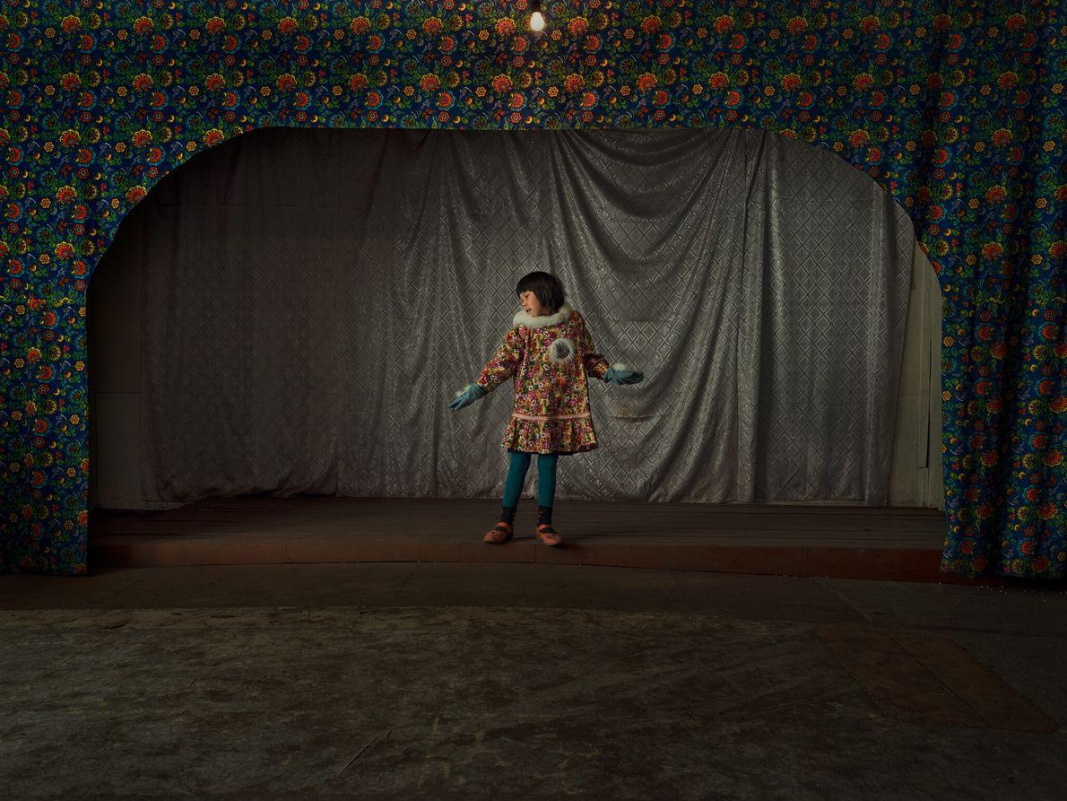 Vika Taenom wears a customary Chukchi dress called a kamleika as she rehearses a traditional dance ...