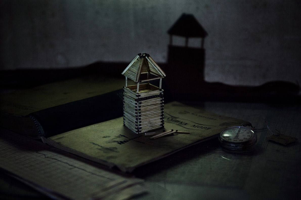 A lighthouse model that Korotki is building from matches seems to cast a shadow of the ...
