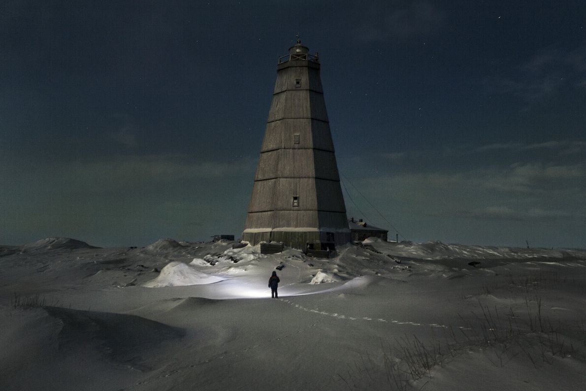 Korotki walks toward a lighthouse that went out of service over 10 years ago. When he ...
