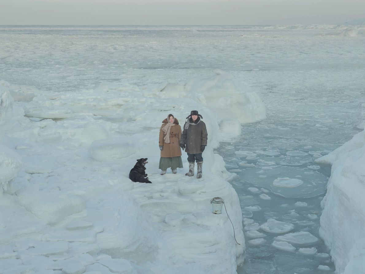 Kostikova and Sivkov, joined by their dog, Dragon, collect water samples to measure the salinity of ...
