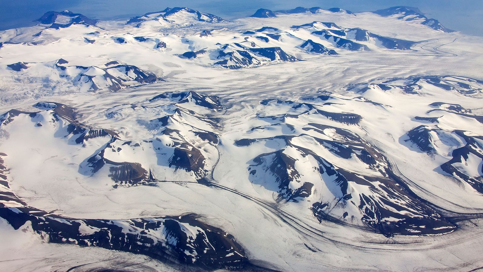 An aerial view of mountainous landscape of glaciers in Norway that could contain microplastics in their ...