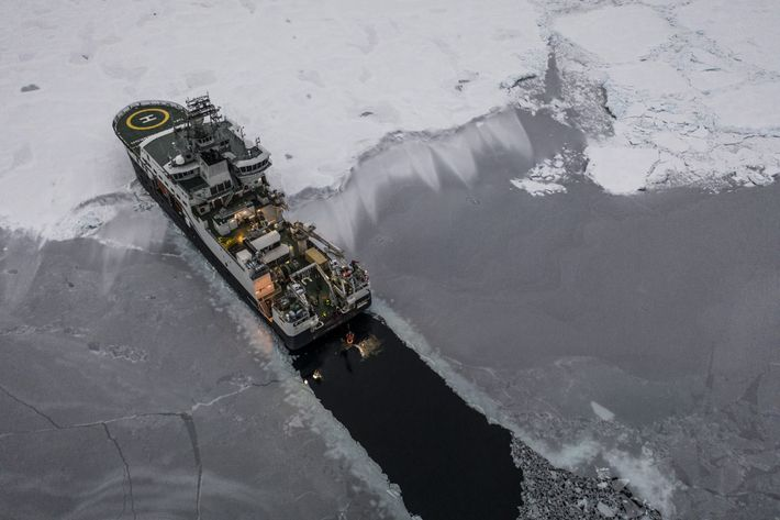 The icebreaker Kronprins Haakon cuts a dark path through Arctic ice cover as scientists with the ...