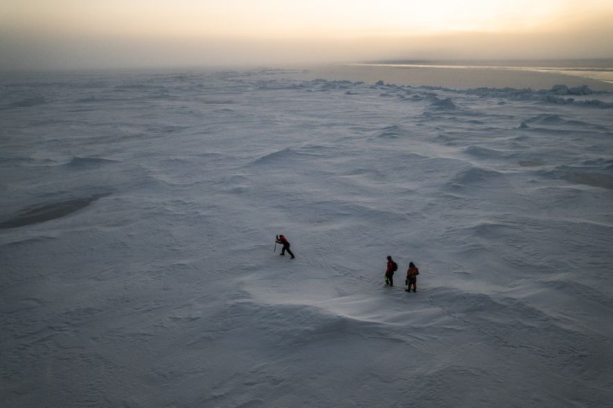 NASA scientist Kevin Hand (left), engineer Andrew Klesh, and biologist Dimitri Kalenitchenko of UiT–The Arctic University ...