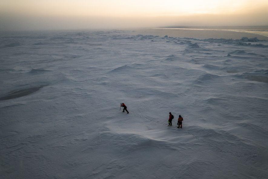 NASA scientist Kevin Hand (left), engineer Andrew Klesh, and biologist Dimitri Kalenitchenko of UiT–The Arctic University ...