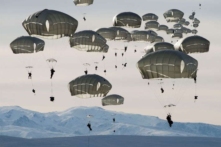 U.S. soldiers drop over the Donnelly Training Area near Fort Greely, Alaska. In October 2018 the ...
