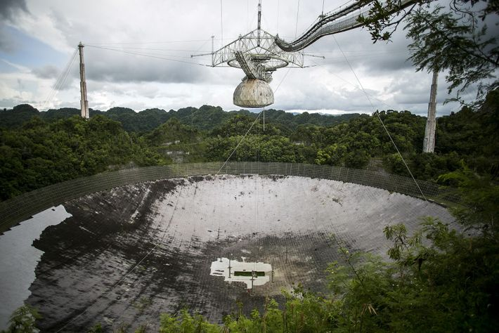 The platform suspended above Arecibo's radio dish holds many of the observatory's scientific instruments, and it ...