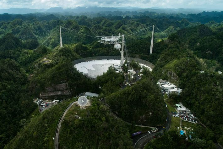 Arecibo's great dish is seen nestled among the rocky hills of northern Puerto Rico on February ...