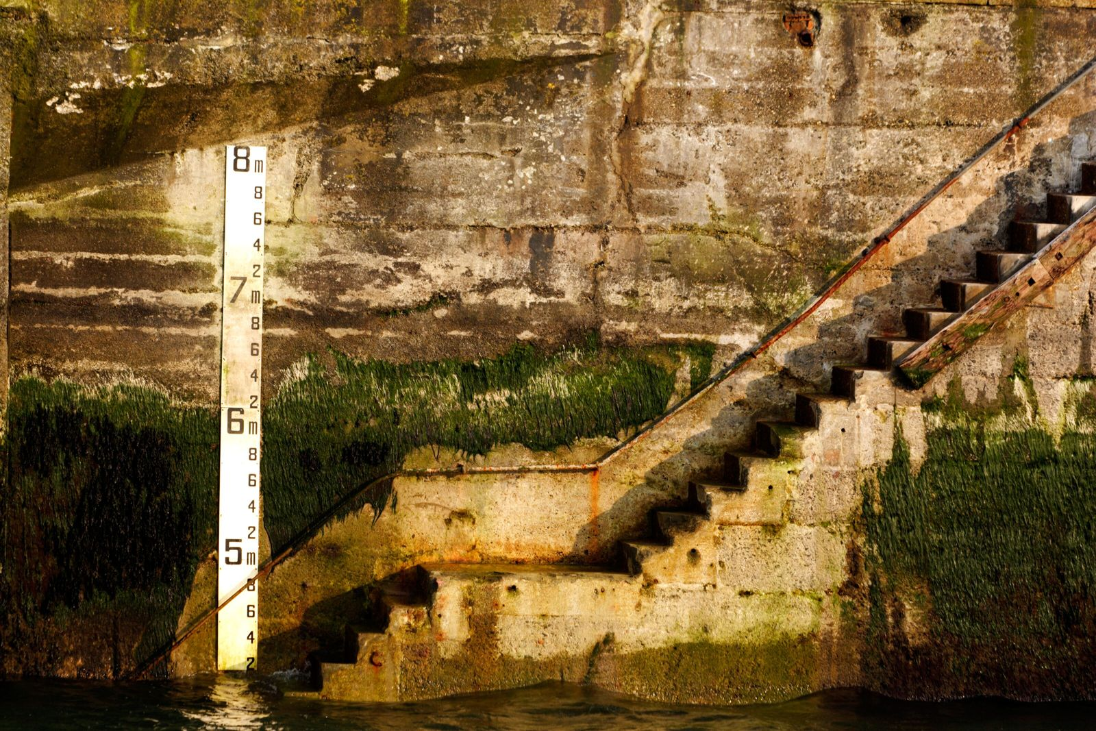 A sea level gauge beneath the quay at Newlyn. The Cornish location was chosen due to its ...