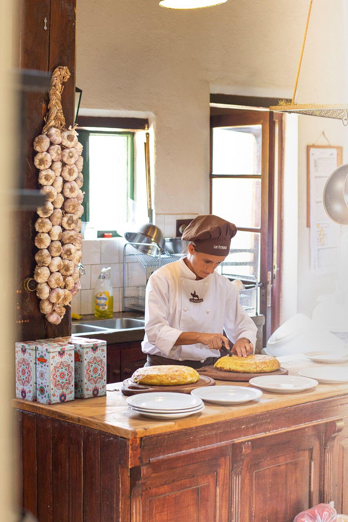Chef Paula Delgado prepares a tortilla de papas, or Spanish omelette, made with potatoes and onions, ...