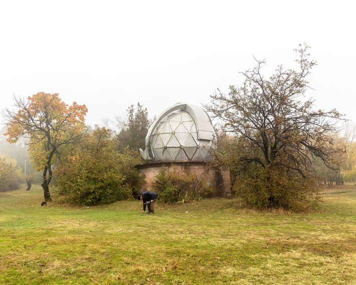 A scientist picks a mushroom for his grandson on the Byurkan Astronomical Observatory complex further down ...
