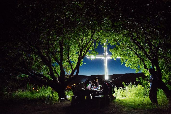 Villagers in Bagaran, Armenia, sing of cultural endurance and survival while picnicking at night beneath apricot ...