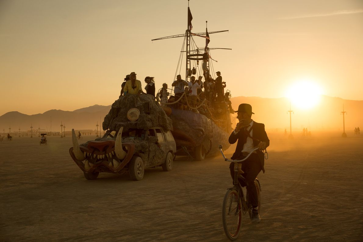 """Besides bicycles, attendees use """"art cars"""" like the one seen here, to transport larger groups."""