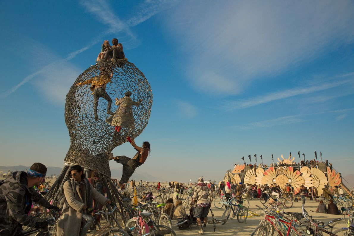 After the burning of the Veils, people congregate around some of the art built for Burning ...