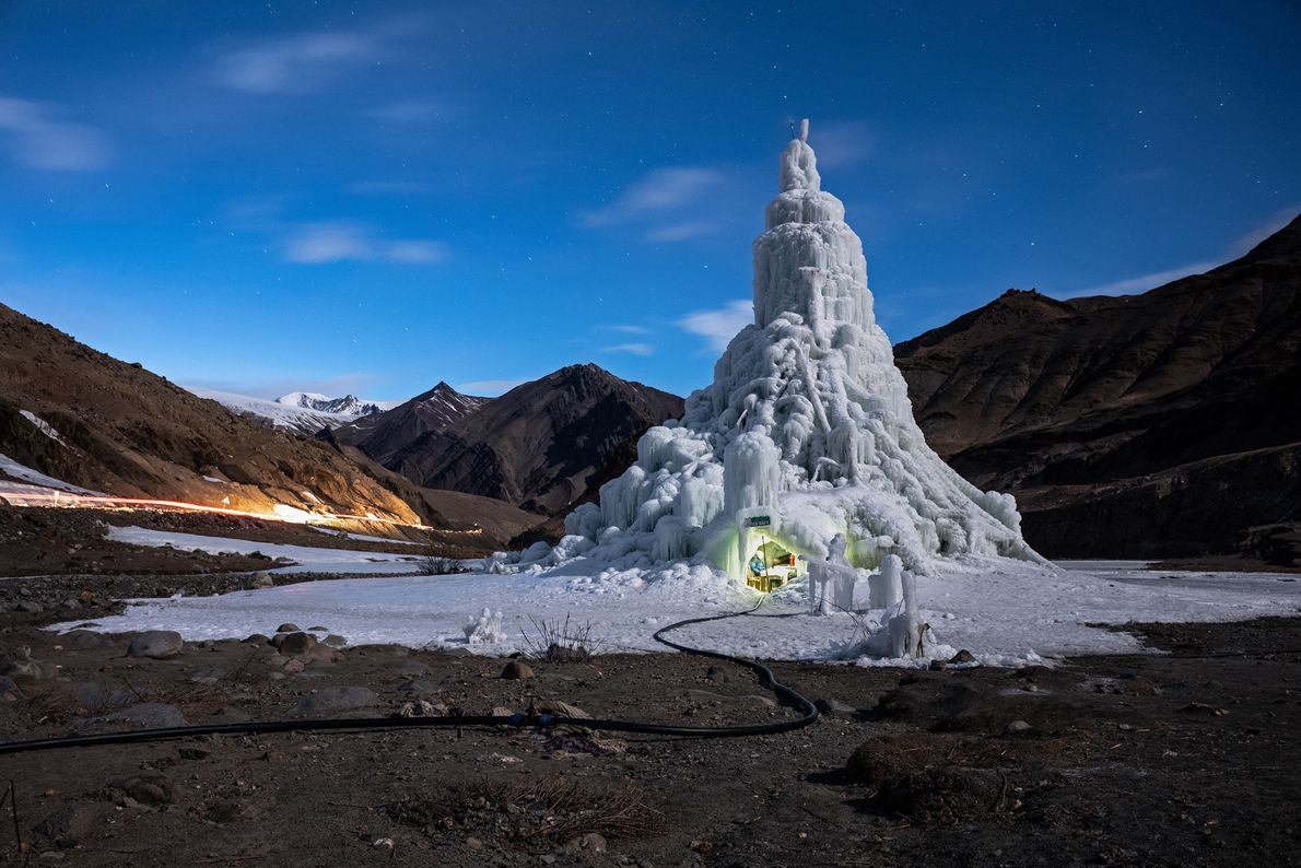 Conical ice stupas serve as water towers, storing winter meltwater for spring planting. The youth group ...