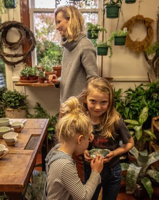 Artist Hayley Richards with two of her three children in a Nelson gallery. The town is ...