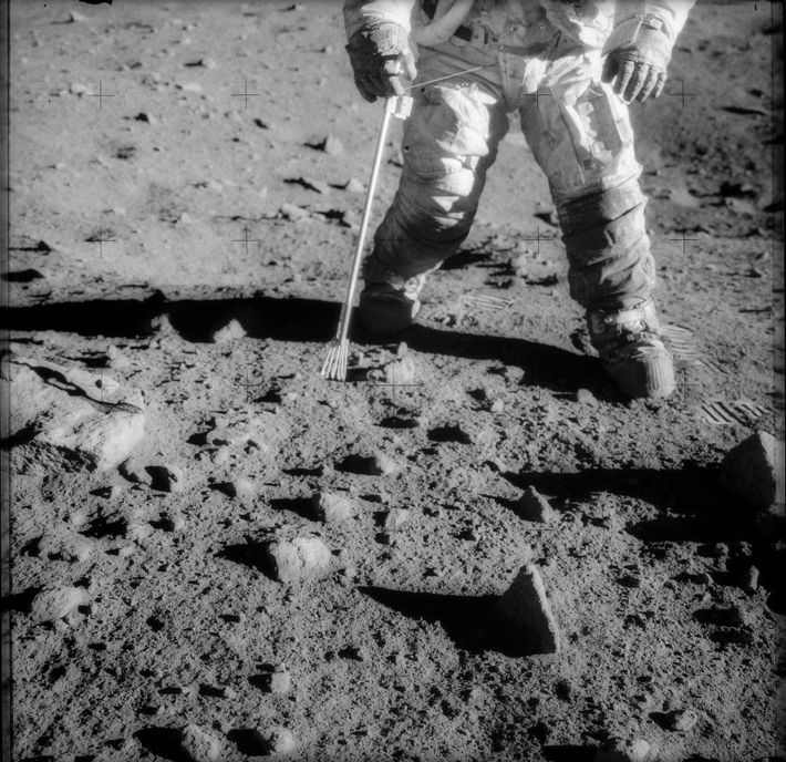 Lunar soil is clearly visible on the suit of astronaut Charles Conrad Jr., commander of the ...
