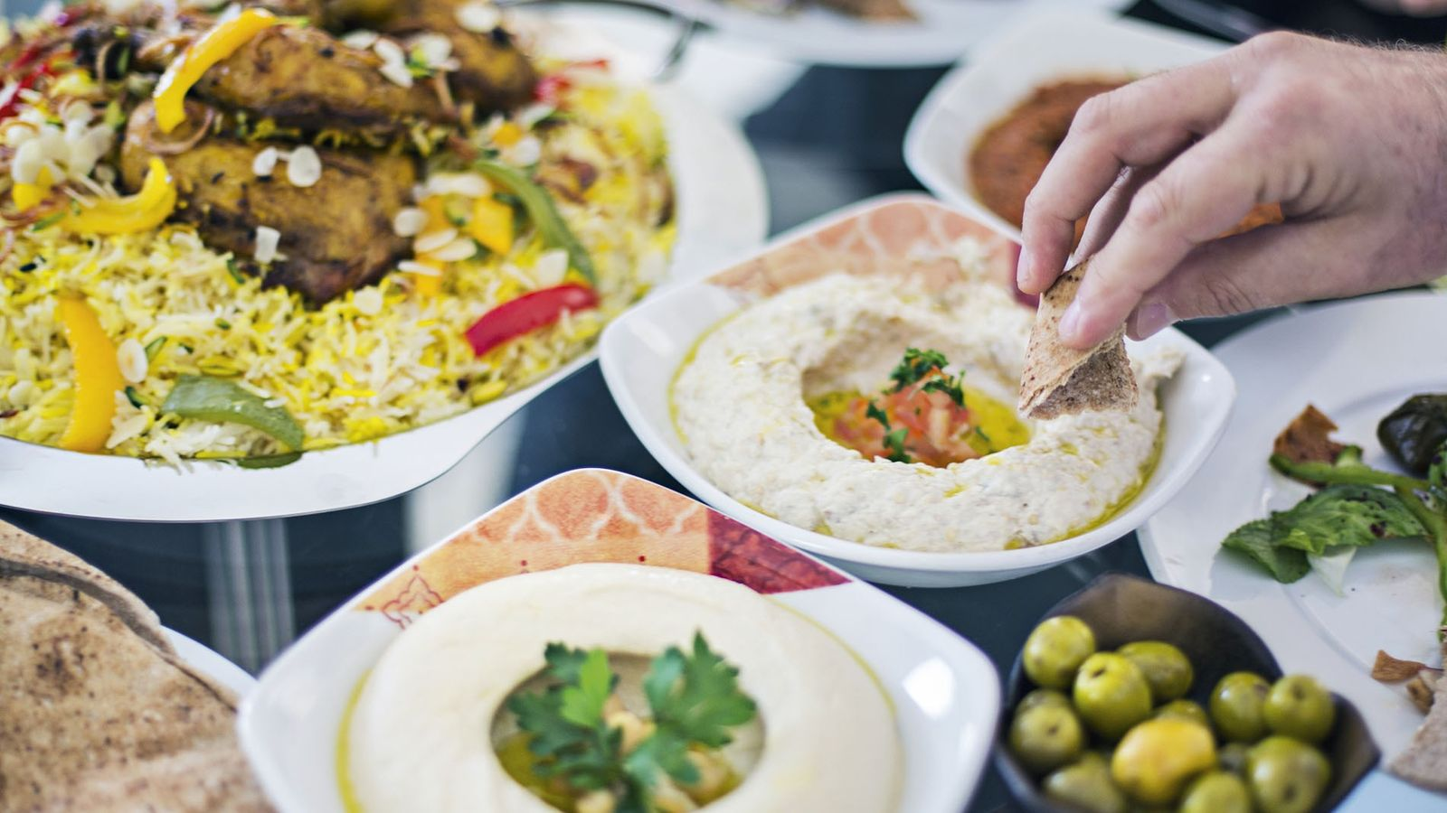 Dinning table filled with different mezze.