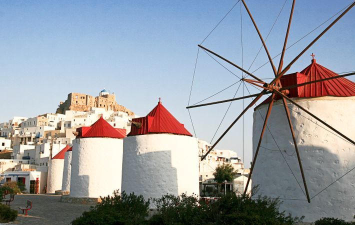 Astypalea offers deserted beaches and photogenic villages of white houses, blue-domed churches and red-roofed windmills.