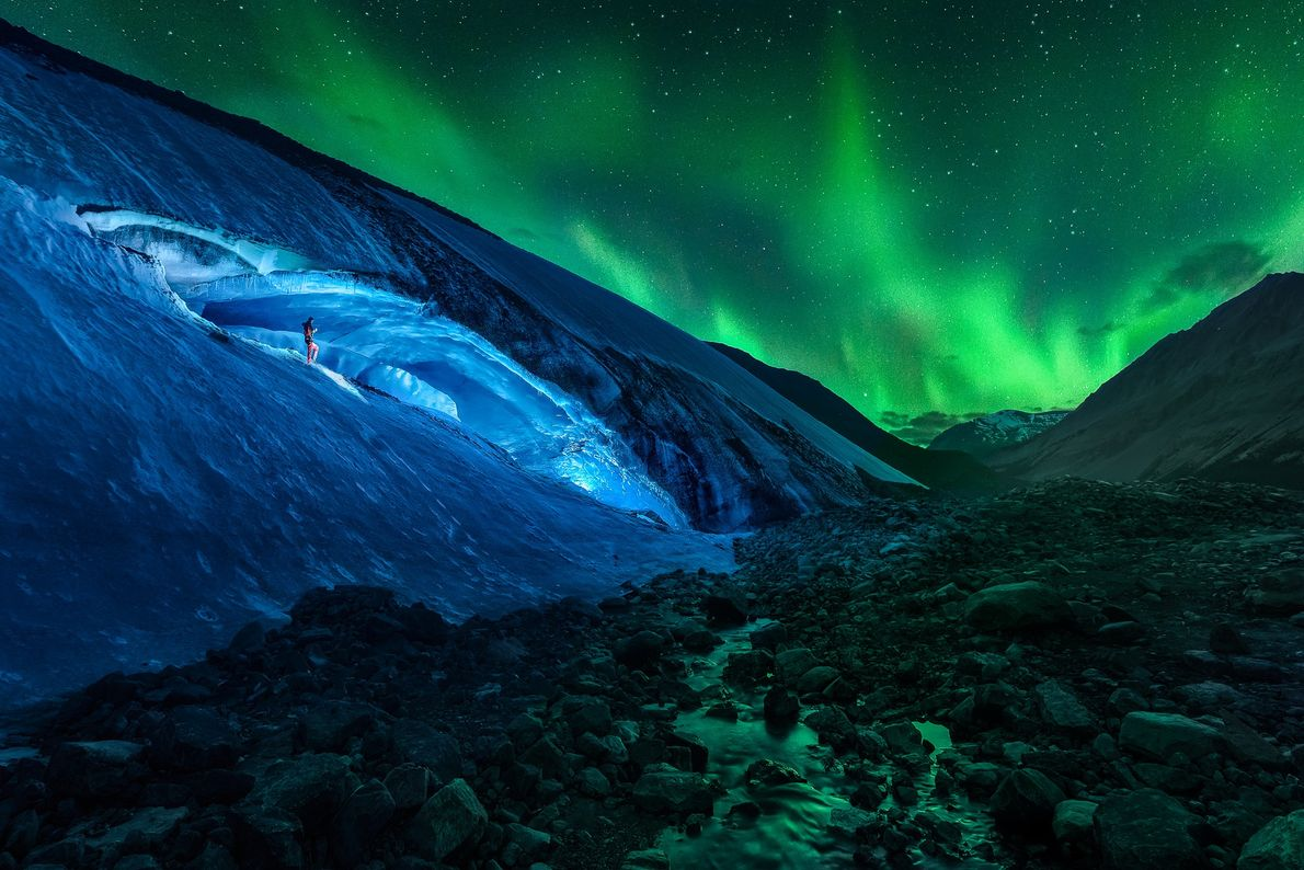 Athabasca Cave and northern lights seen in Jasper National Park, Alberta, Canada.