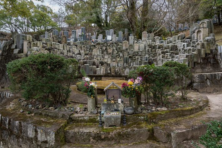 Victims of the bomb rest in peace in a hillside cemetery on the wooded ground of ...
